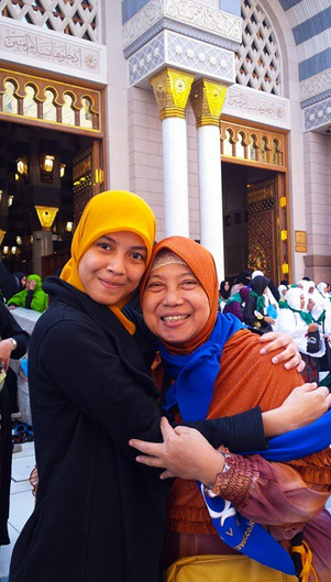 Me and Mom in front of Nabawi Mosque, Maddinah, Dec 2014.